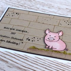 Geprägte Männerkarte mit einem Glücksschweinchen