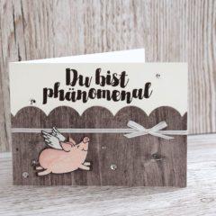 Grusskarte mit einem Glücksschweinchen